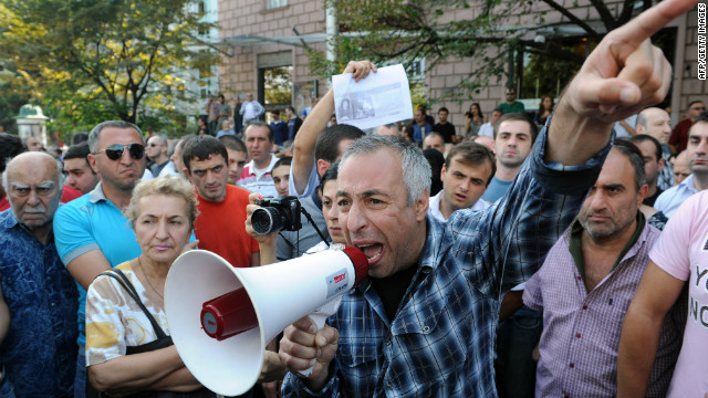 Protesters rally against torture in prisons in Tbilisi on September 19, 2012.