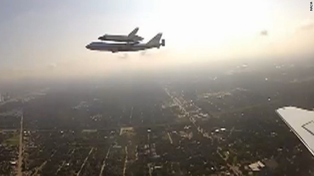 NASA's shuttle endeavour flies over Houston, attached to a modified 747.