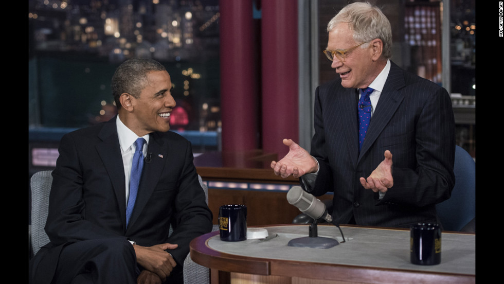 "Obama and David Letterman speak during a break in the taping of the ""Late Show with David Letterman"" at the Ed Sullivan Theater on Tuesday in New York."