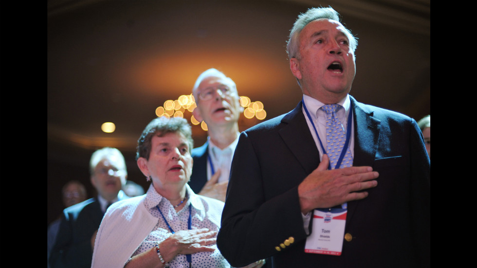 Attendees sing the National Anthem during The Family Research Council  Action Values Voter Summit on Friday in Washington. The summit is an annual political conference for U.S. social conservative activists and elected officials.