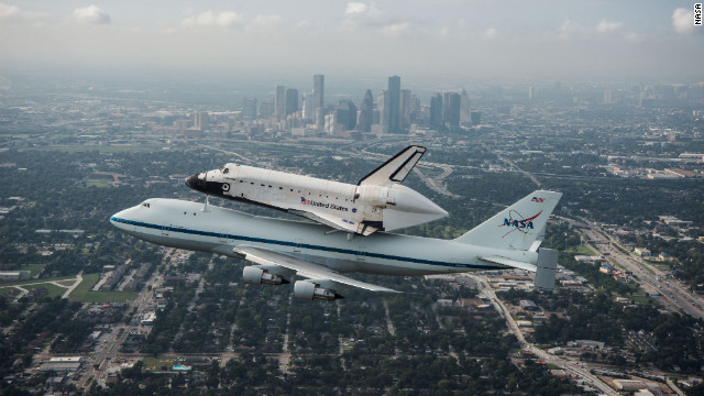 Space Shuttle Endeavour is ferried by NASA's Shuttle Carrier Aircraft (SCA) over Houston, Texas on September 19, 2012. NASA pilots Jeff Moultrie and Bill Rieke are at the controls of the Shuttle Carrier Aircraft. Photo taken by  NASA photographer Sheri Locke in the backseat of a NASA T-38 chase plane with NASA pilot Thomas E. Parent at the controls. Photo Credit: NASA/ Sheri Locke