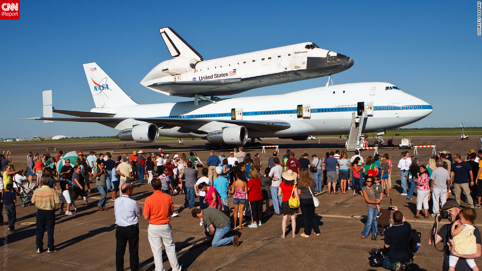 "The public was invited to <a href=""http://ireport.cnn.com/docs/DOC-844016"">view the shuttle</a> as it rested at Ellington Field."
