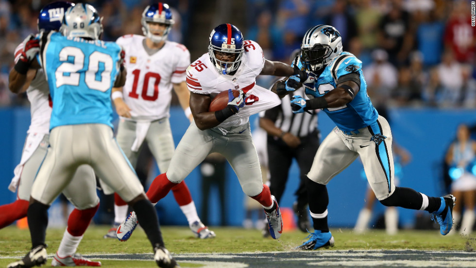 Andre Brown of the New York Giants runs the ball in the first quarter against the Carolina Panthers on Thursday.