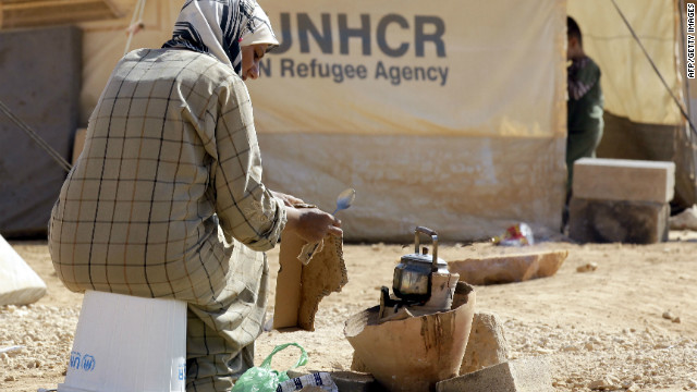 A Syrian refugee makes tea outside her tent at Zaatri refugee camp, near the Jordanian border with Syria, on September 13, 2012.