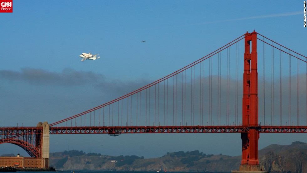 "Endeavour completed a flyover of San Francisco before continuing on to Los Angeles. Here, it makes a pass <a href=""http://ireport.cnn.com/docs/DOC-845053"">over the Golden Gate Bridge</a>."