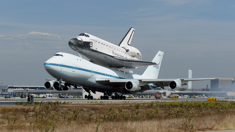 Space shuttle Endeavour makes its final landing at the Los Angeles International Airport on Friday.