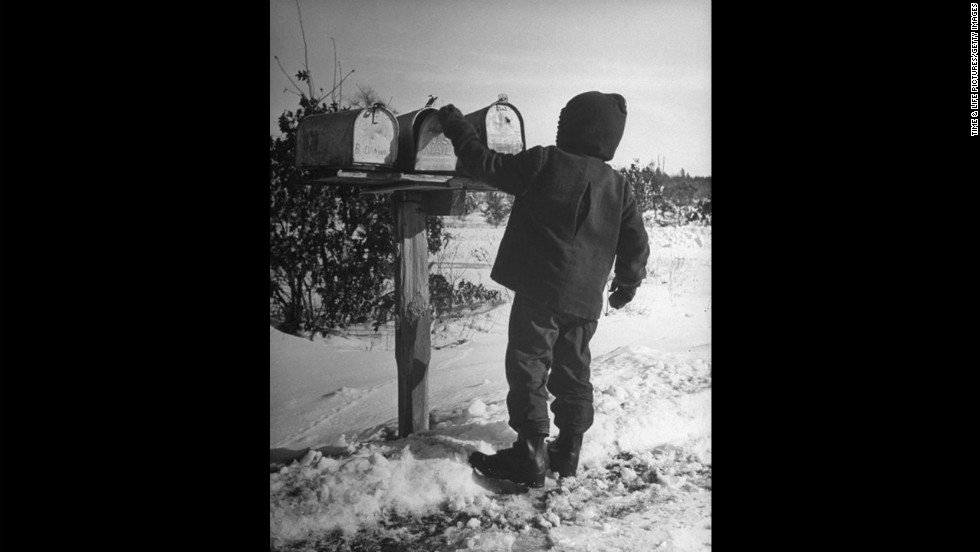 "A Wisconsinite opens the family mailbox in 1946. <a href=""http://life.time.com/history/the-postal-service-classic-photos/#1"" target=""_blank"">See more photos of the classic Postal Service from Life.com</a>."