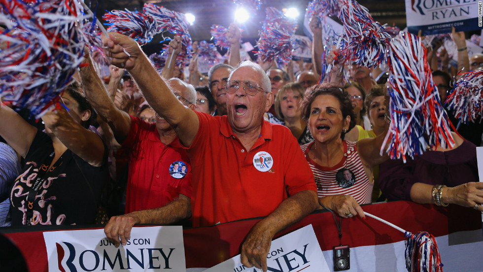 Supporters cheer as they listen to Romney speak during a Juntos Con Romney Rally at the Darwin Fuchs Pavilion on Wednesday, September 19, in Miami.