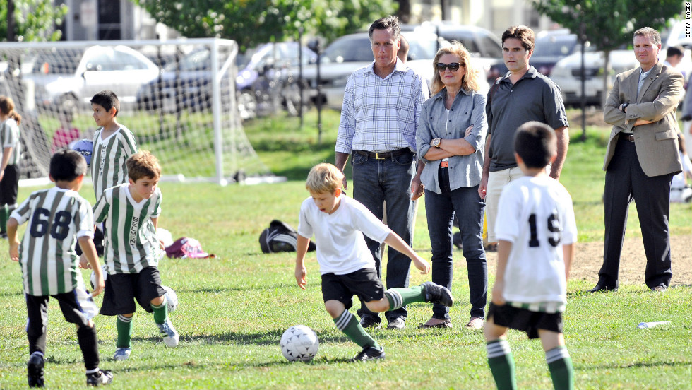 From left to right: Mitt Romney, his wife Ann, and son Tagg watch one of Tagg's sons play soccer in Belmont, Massachusetts, on Saturday.