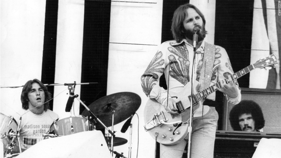 Carl Wilson performs guitar and vocals and Dennis Wilson drums in a live performance, July 1975.