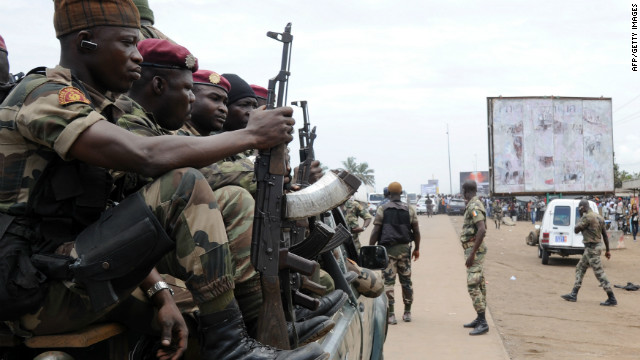 Ivory Coast soldiers patrol the the road leading to Ghana on the outskirts of Abidjan on September 21, 2012.