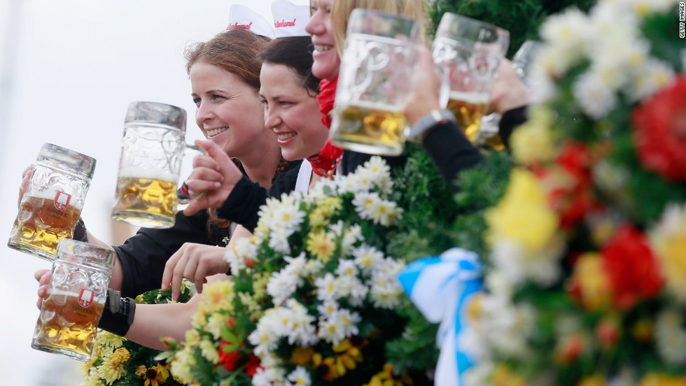 "Waitresses of the Spaten brewery wave with beer mugs. <a href=""http://www.cnn.com/SPECIALS/world/photography/index.html"" target=""_blank"">See more of CNN's best photography</a>."