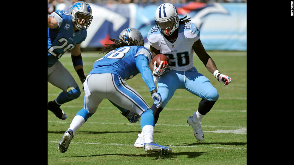Bill Bentley of the Detroit Lions squares up to try to tackle Chris Johnson of the Tennessee Titans.