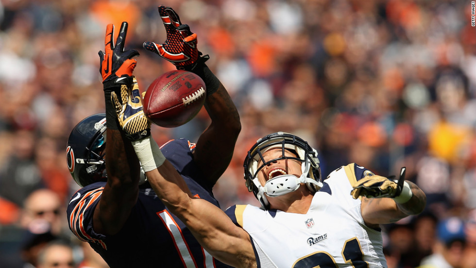 Cortland Finnegan of the Rams breaks up a pass intended for Alshon Jeffery of the Bears.