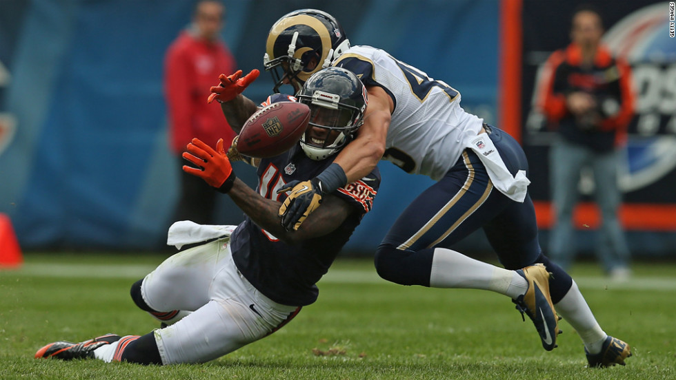 Brandon Marshall of the Bears tries to catch a pass Sunday as he is hit by the Rams' Craig Dahl.