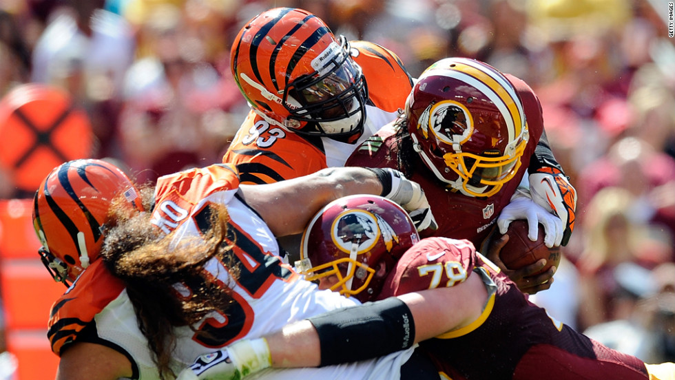 Quarterback Robert Griffin III of the Washington Redskins is sacked by No. 93 Michael Johnson of the Cincinnati Bengals.