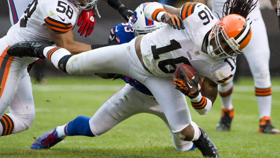 Josh Cribbs of the Cleveland Browns is tackled by Nigel Bradham of the Buffalo Bills on Sunday.