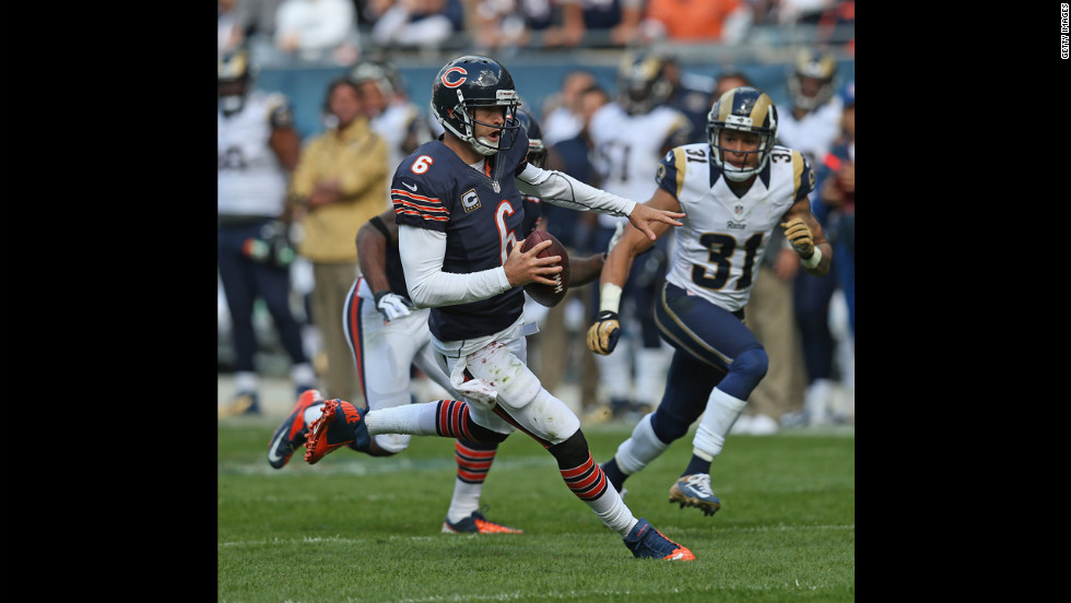 The Bears' Jay Cutler runs for a first down against the Rams.