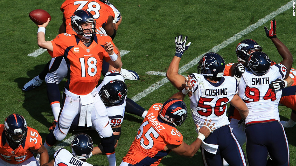 Peyton Manning of the Denver Broncos drops back to pass Sunday against the Houston Texans.