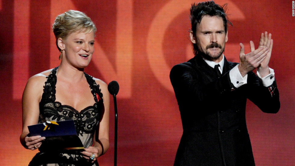 "Martha Plimpton, winner of best guest actress in a drama for ""The Good Wife,"" and Jeremy Davies, winner of best guest actor in a drama for ""Justified,"" address the audience."