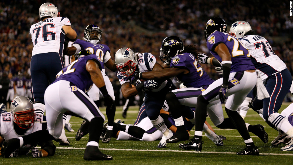 Brandon Bolden of the New England Patriots scores a two-yard rushing touchdown in the first quarter against the Baltimore Ravens on Sunday in Baltimore.