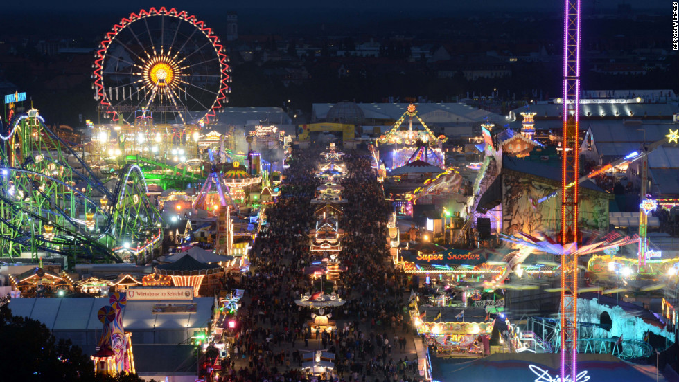 The attractions light up the fairgrounds on the first night of the festival on Saturday.