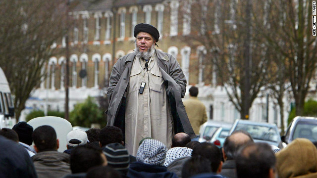 Abu Hamza al-Masri addresses followers near Finsbury Park mosque in London in 2004.