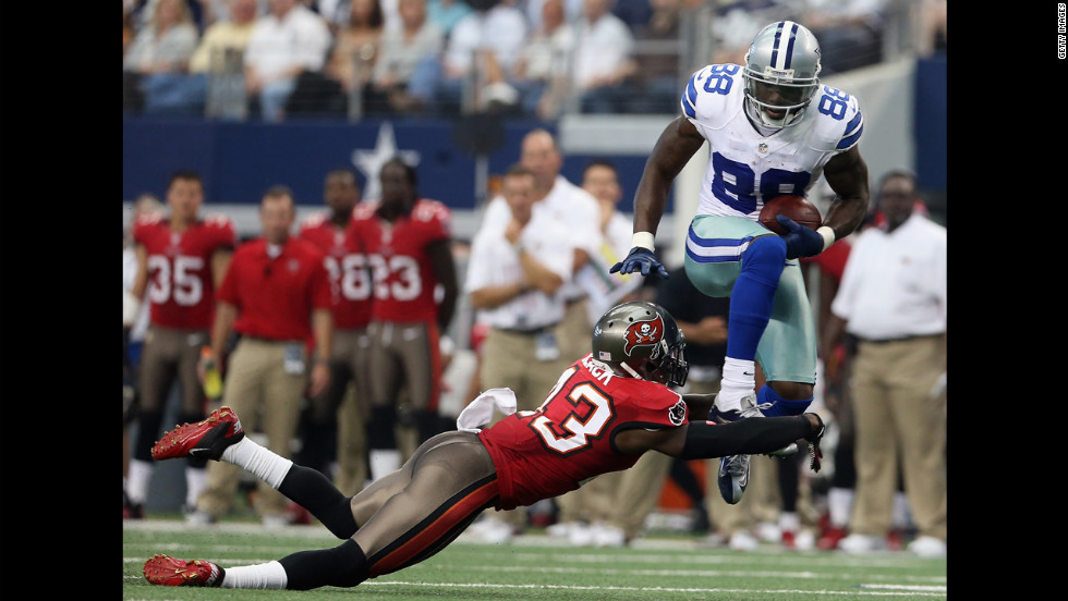 Dez Bryant of the Dallas Cowboys runs the ball Sunday against Ahmad Black of the Tampa Bay Buccaneers.