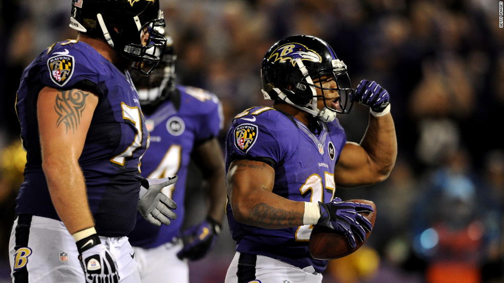The Ravens' No. 27 Ray Rice celebrates after he scored a seven-yard rushing touchdown in the third quarter against the New England Patriots on Sunday.