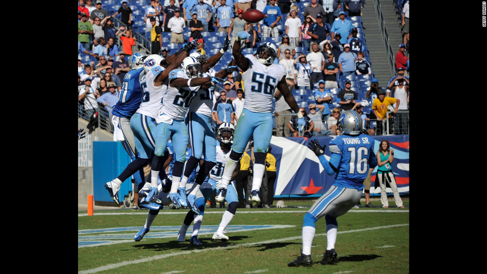 No. 56 Akeem Ayers of the Titans bats down a hail mary pass intended for the Lions' Titus Young.