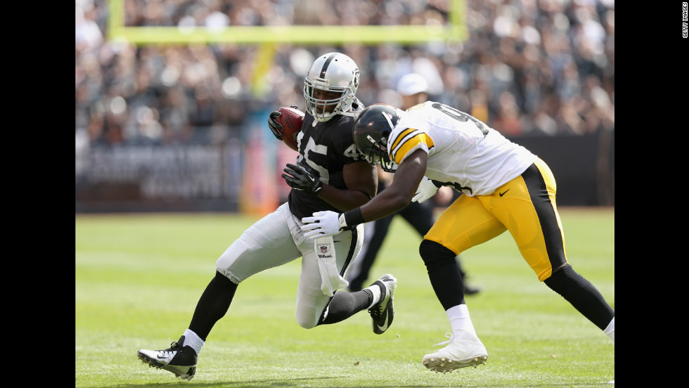 Oakland's Marcel Reece is hit by Pittsburgh's Lawrence Timmons.