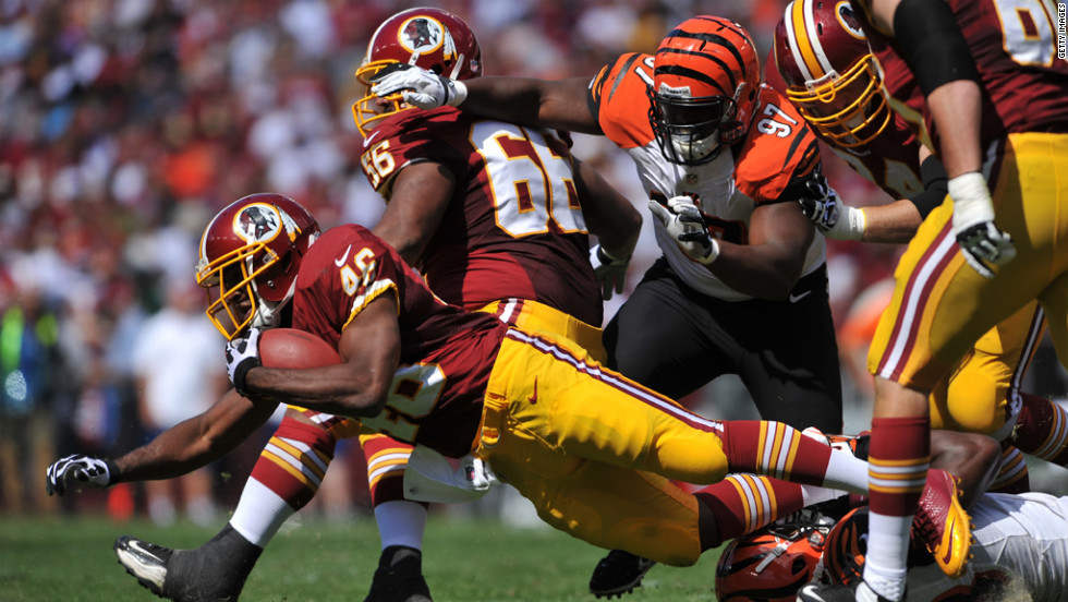 Washington's Alfred Morris dives after a run against Cincinnati.