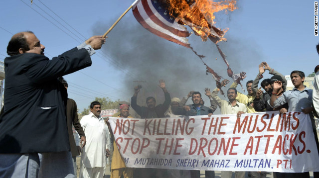 A Pakistani man burns an American flag during a protest against U.S. drone attacks in Multan on February 9, 2012.