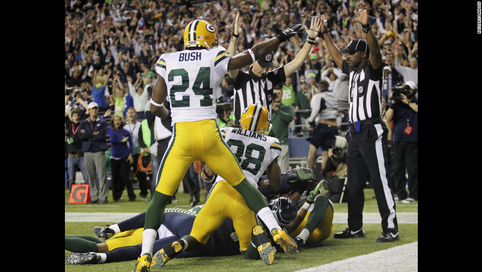 """The play was reviewed on video but was ruled a touchdown. <a href=""""http://www.cnn.com/2012/09/20/football/gallery/nfl-week-3/index.html"""">See the best of NFL Week 3</a>."""