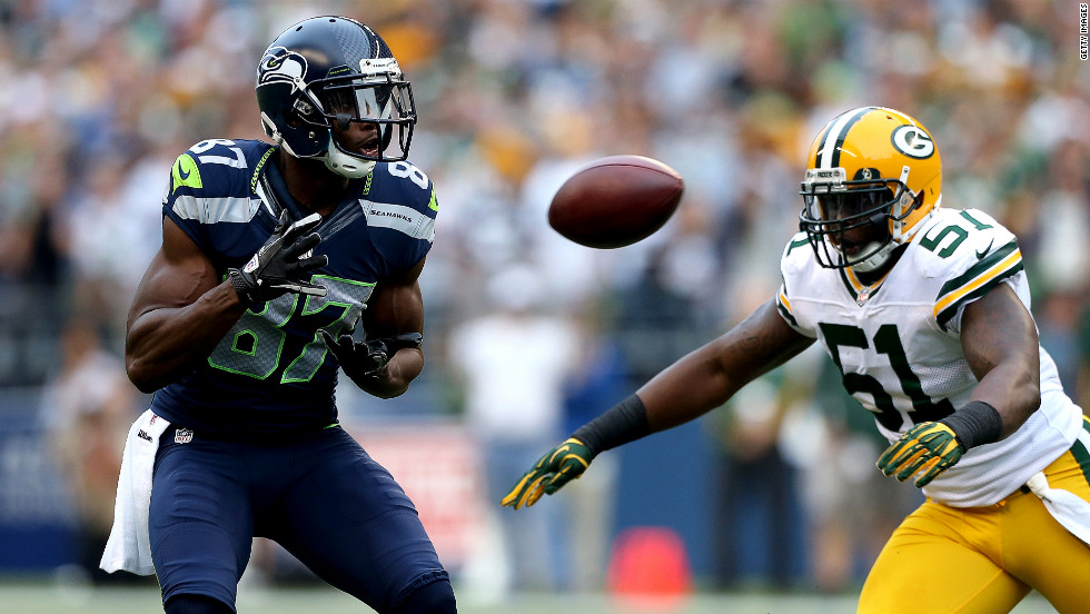 Ben Obomanu of the Seattle Seahawks prepares to catch a pass as D.J. Smith of the Green Bay Packers defends on Monday.