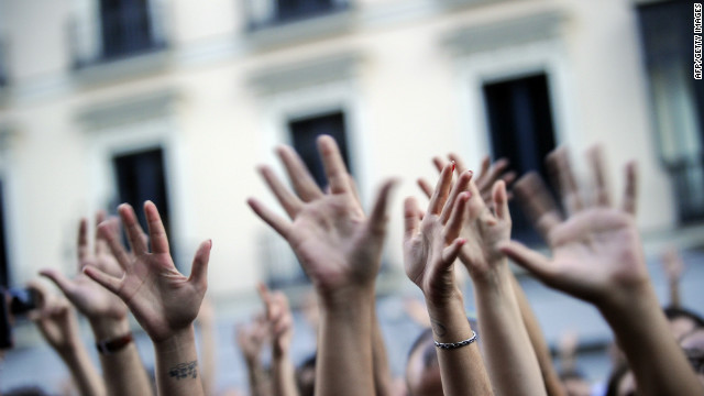 Demonstrators raise their hands as they take part in an anti-austerity protest in Madrid on September, 2012. Hundreds of Spaniards marched in Madrid to protest over hardships in a recession brought on by the financial crisis that they blame on banks and corrupt politicians. AFP PHOTO/Pedro ARMESTRE (Photo credit should read PEDRO ARMESTRE/AFP/GettyImages)