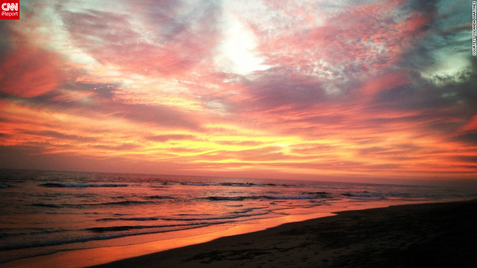 "The first autumn sunset on Huntington Beach, California, filled Yolanda Martinez with a sense of joy, and a desire to share the beauty with the world. She <a href=""http://ireport.cnn.com/docs/DOC-847515"">shot this photo</a> with her iPhone."