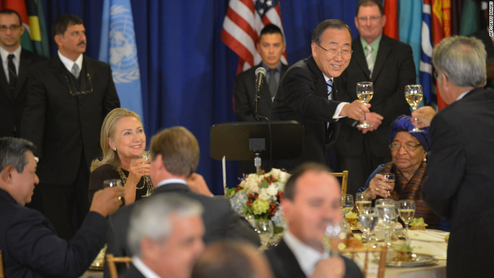 United Nations Secretary-General Ban Ki-moon, standing, makes a toast during a luncheon on Tuesday as U.S. Secretary of State Hillary Clinton, left, looks on.