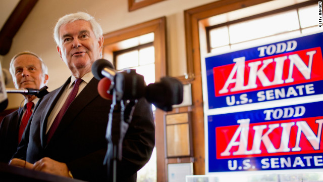 Former House Speaker Newt Gingrich is backing the embattled Senate bid of Rep. Todd Akin, background.