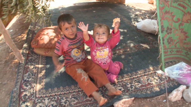 Syrian refugees living in olive orchards
