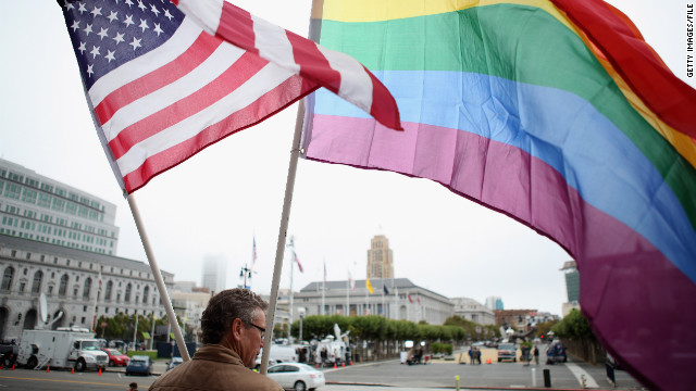 A demonstrator waves American and gay pride flags in San Francisco in 2010. California law bans same-sex marriage.