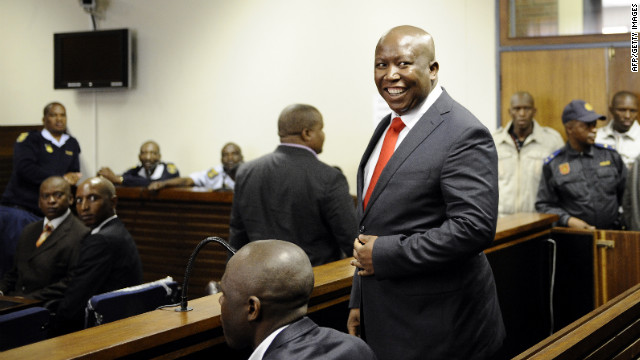 South African populist firebrand Julius Malema, a former leader of the African National Congress' (ANC) Youth, smiles as he arrives in court on September 26, 2012 in Polokwane, charged with money laundering, fraud and corruption linked to public tenders, in a case that his supporters say is politically motivated. Malema was released on bail with a fee set at 10,000 rand (945 euro, $1,215).  AFP PHOTO / STEPHANE DE SAKUTIN        (Photo credit should read STEPHANE DE SAKUTIN/AFP/GettyImages)