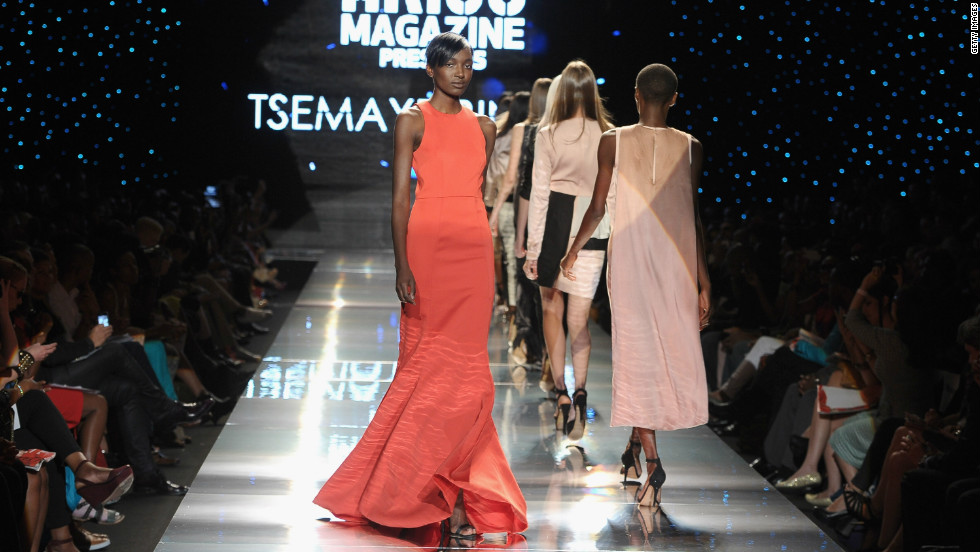 "Tsemaye Binite's show was dominated by ""marl grey jersey tracksuits with silver embossed branding, leather bomber jackets worn with denim shorts, flesh-toned panelled illusion dresses and a floor-sweeping, blood-red evening gown,"" Jennings said."