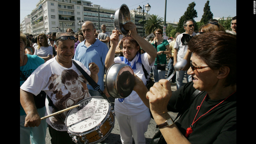Protesters shout slogans and play makeshift instruments Wednesday.