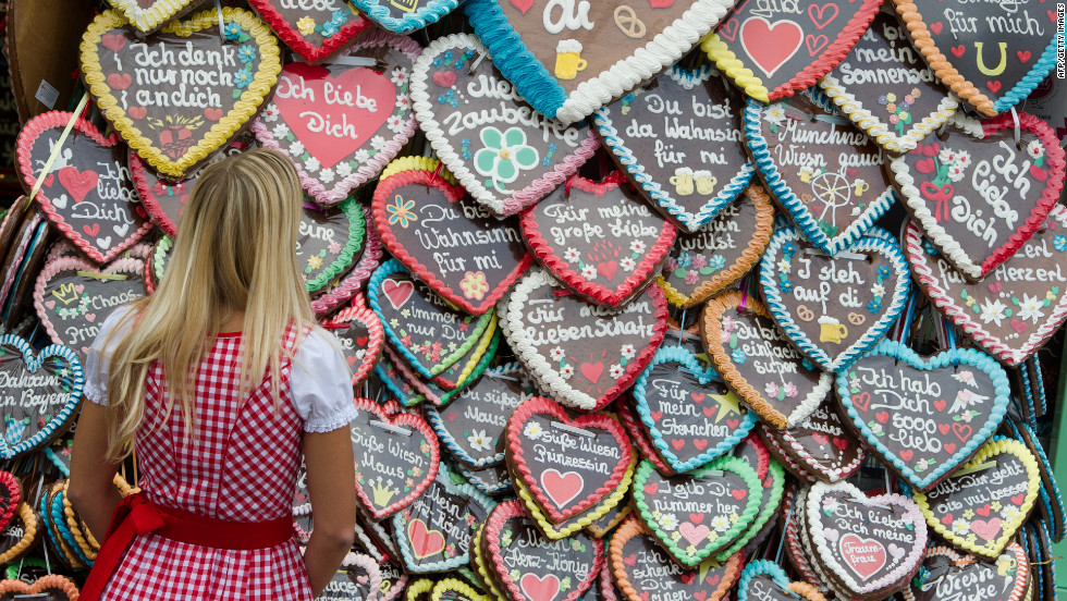 A woman stands in front of gingerbread hearts on Wednesday, September 26, the fifth day of the festival.