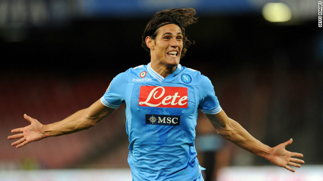 Edinson Cavani celebrates one of his three goals as Napoli beat Lazio 3-0 in the Stadio San Paolo to join Juventus atop Serie A