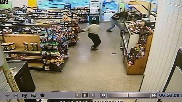 clerk throws beer cans at robber_00003729