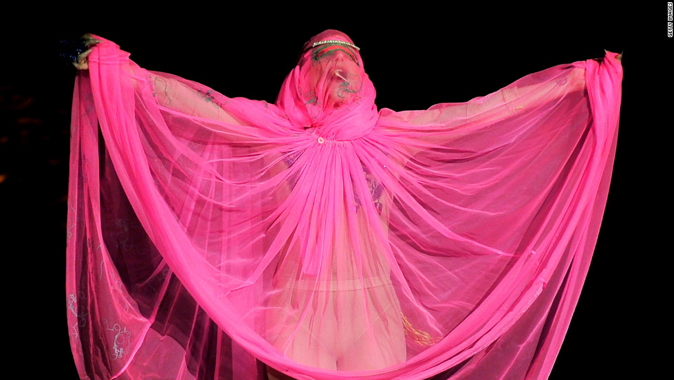 Lady Gaga drapes herself in pink on the catwalk at the Philip Treacy fashion show in 2012.