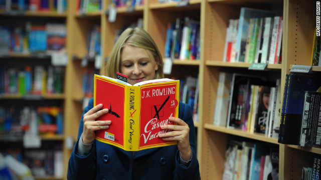 A member of staff poses with a copy of 'The Casual Vacancy', the new novel by British author J K Rowling, in a bookshop in central London on September 27, 2012, as it goes on sale for the first time. First reviews of Harry Potter author JK Rowling's novel for adults praised its Dickensian scope and social message, but warned the gritty, even obscene tale was a far cry from Hogwarts. AFP PHOTO / CARL COURT (Photo credit should read CARL COURT/AFP/GettyImages)