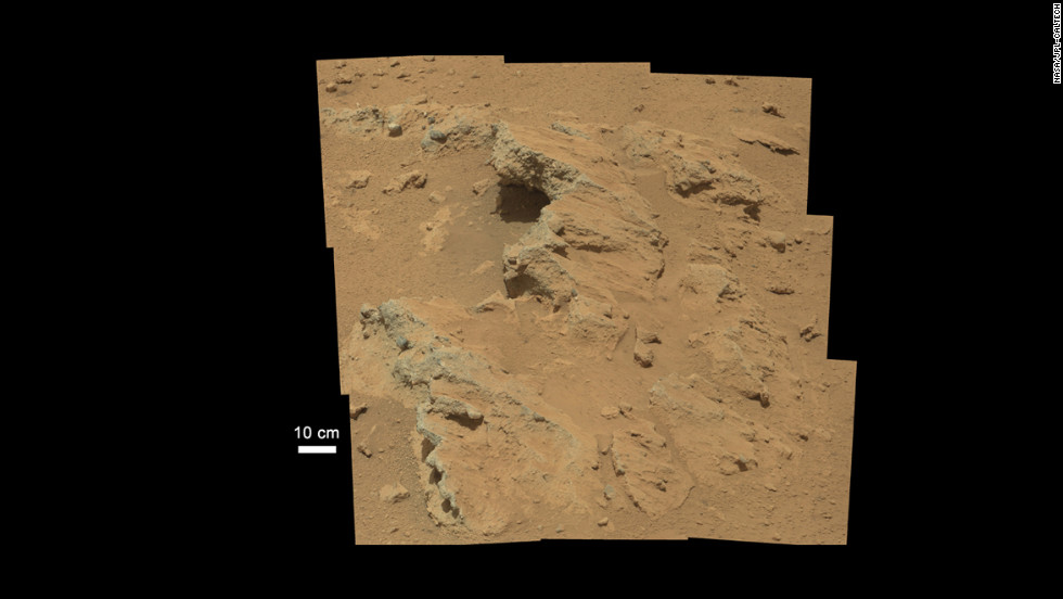 NASA's Curiosity rover found evidence for what scientists believe was an ancient, flowing stream on Mars at a few sites, including the rock outcrop pictured here. The key evidence for the ancient stream comes from the size and rounded shape of the gravel in and around the bedrock, according to the Jet Propulsion Laboratory/Caltech science team. The rounded shape leads the science team to conclude they were transported by a vigorous flow of water. The grains are too large to have been moved by wind.